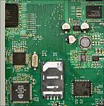 V detailu řadič paměťových karet Alcor Micro AU6375 a EPROM ST Microelectronics